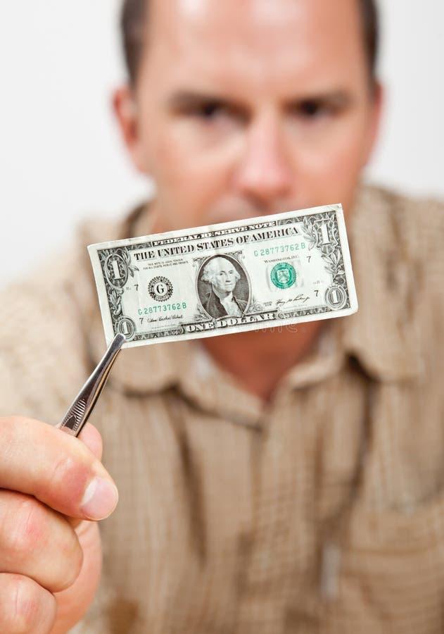 доллар сжимая стоковое фото