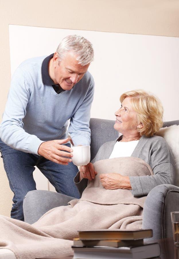 Домашний попечитель и старший пациент стоковое изображение