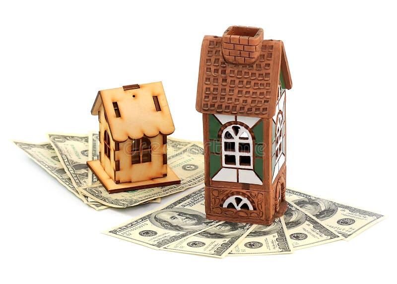 Дома и доллары стоковое изображение