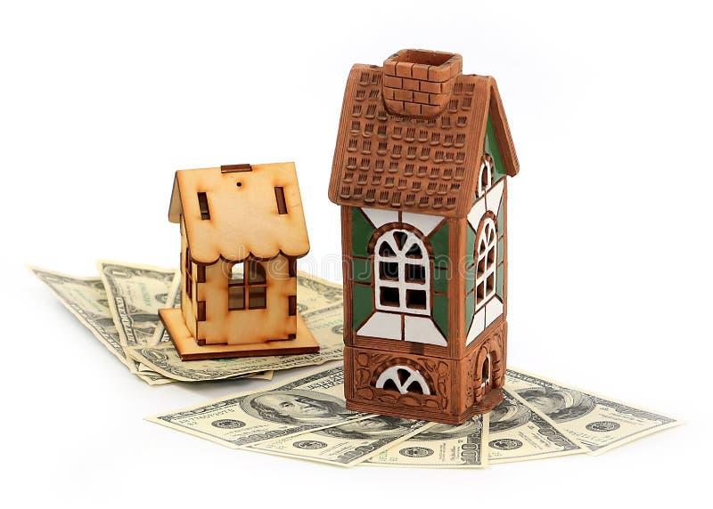 Дома и доллары стоковые изображения