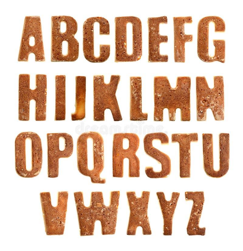 Домодельный алфавит письма печенья на белой предпосылке изолировано стоковое изображение