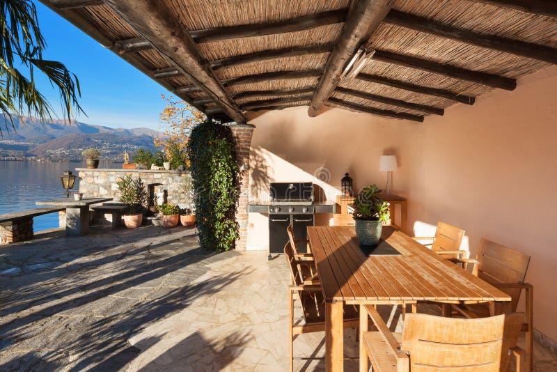 Дом, веранда на заходе солнца стоковое фото