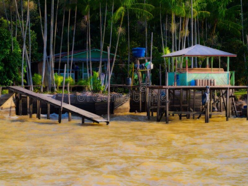 Дом в реке стоковые изображения rf