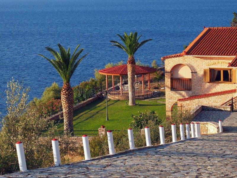 Дом и Cabana берега океана стоковые изображения rf