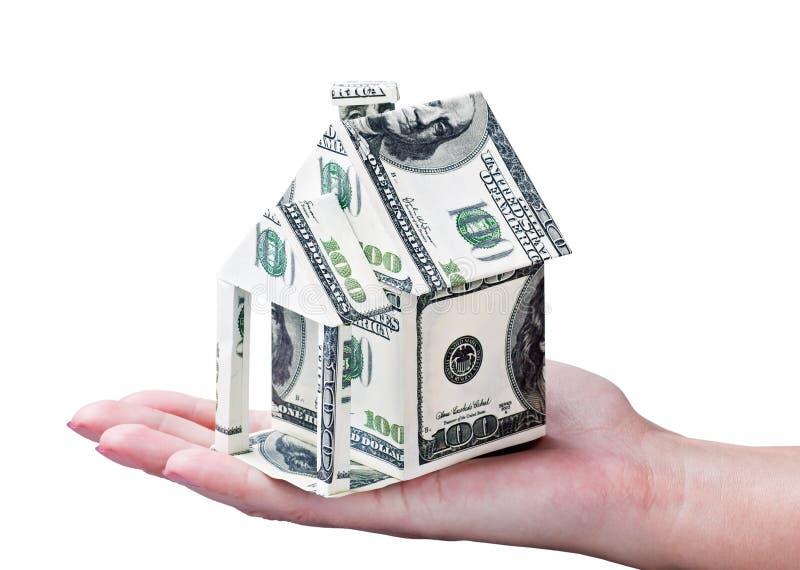 Дом сделанный из денег в руке стоковые изображения rf