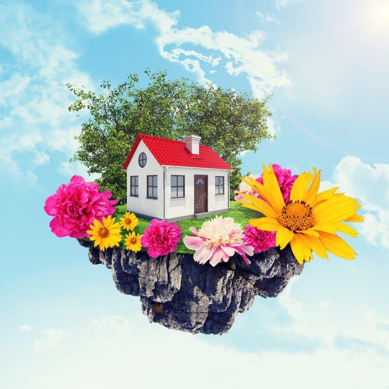 Дом с цветками на острове стоковое изображение rf