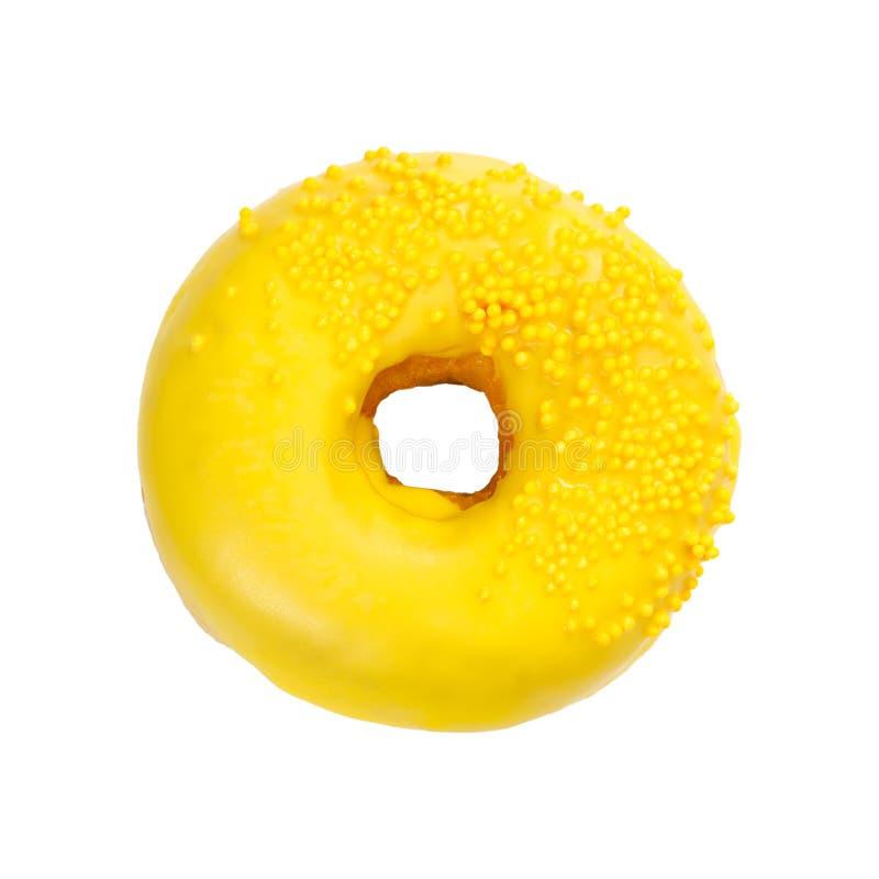Донут с желтой поливой и брызгает стоковые фото