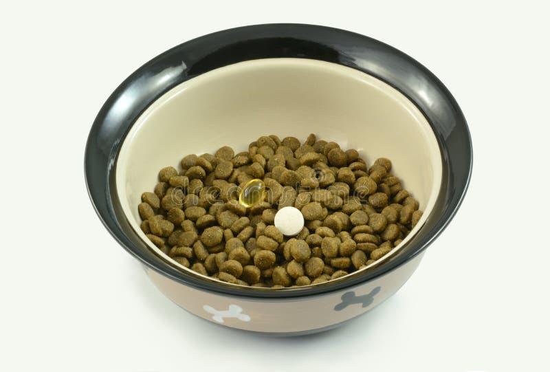 Дополнения собачьей еды стоковое изображение
