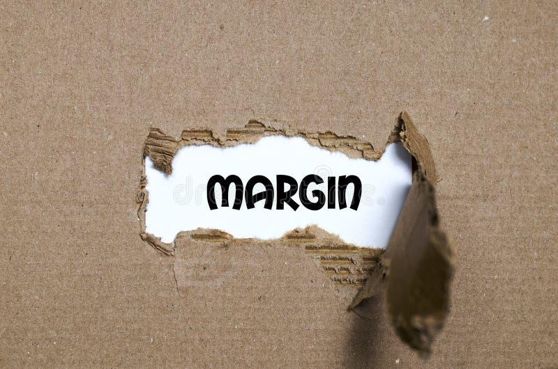 Допустимый предел слова появляясь за сорванной бумагой стоковое изображение