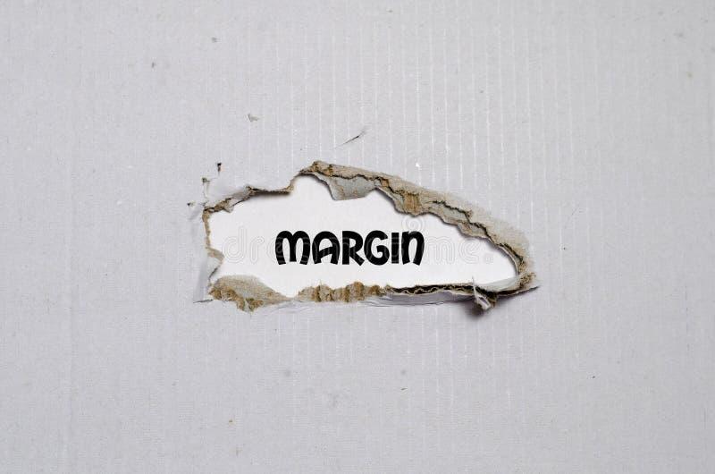 Допустимый предел слова появляясь за сорванной бумагой стоковые изображения rf