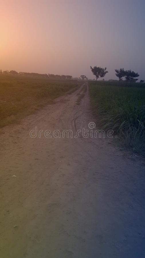 Дорога захода солнца тинная стоковое фото