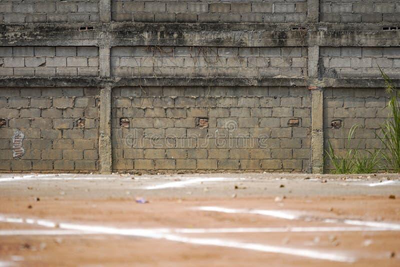 Дорога и земля стены Tele стрельбы фото старые винтажные и гравия нерезкости для большой предпосылки объекта стоковая фотография