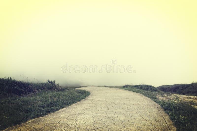 Дорога к нигде с винтажным влиянием фильтра стоковая фотография