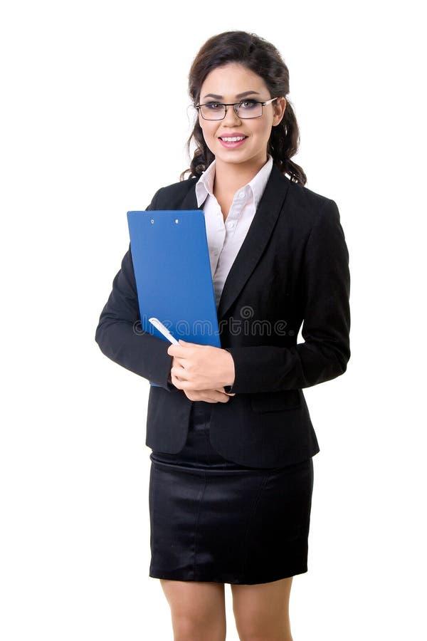 Доска сзажимом для бумаги в руках ` s бизнес-леди стоковые изображения rf