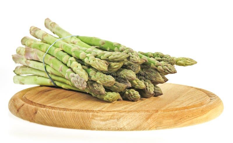 доска спаржи прерывая vegetable деревянное стоковые изображения rf