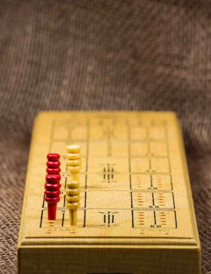 Доска Cribbage конца-вверх стоковая фотография