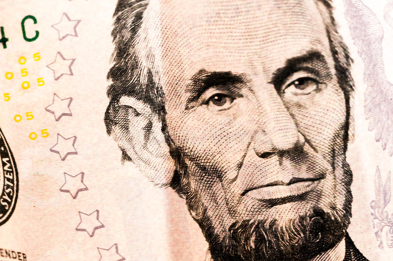 Долларовая банкнота Линкольна денег 5 стоковые фото