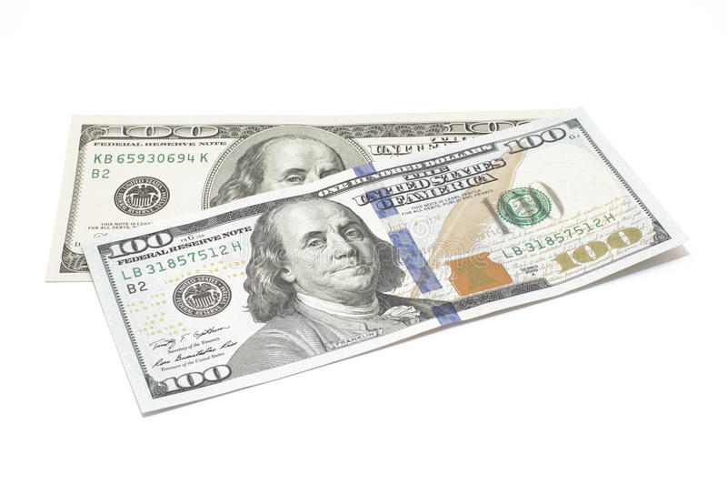 Доллары изолированные на белизне стоковое фото