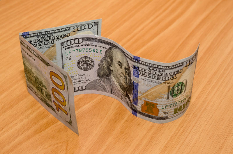 Доллары стрелки стоковые изображения