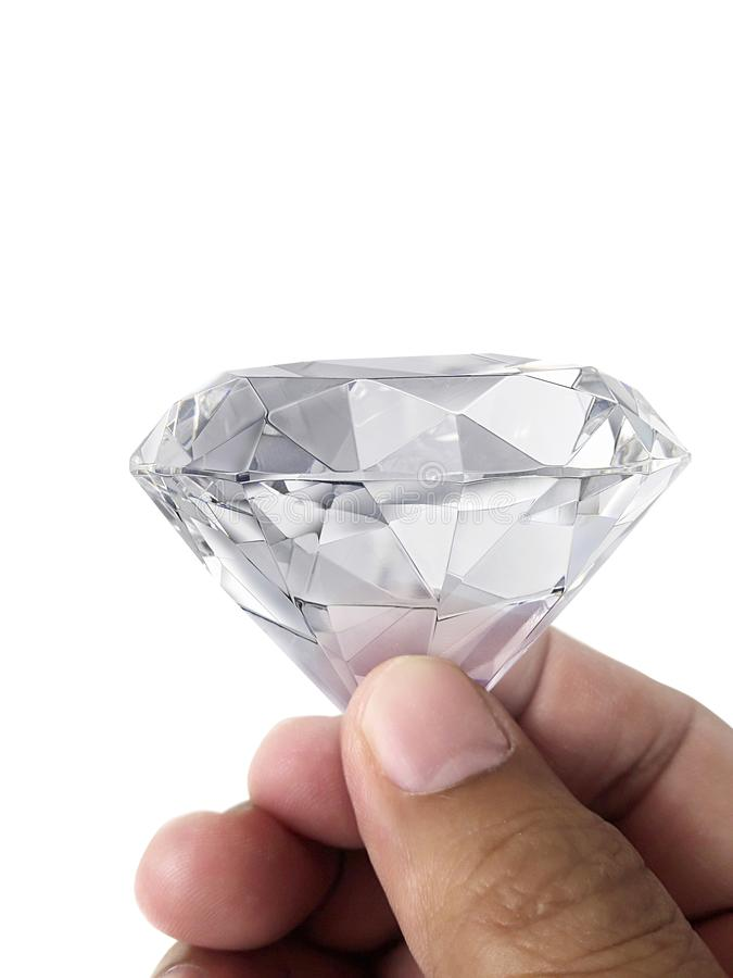 Драгоценность диаманта в руке, изолированной на белой предпосылке стоковые фотографии rf