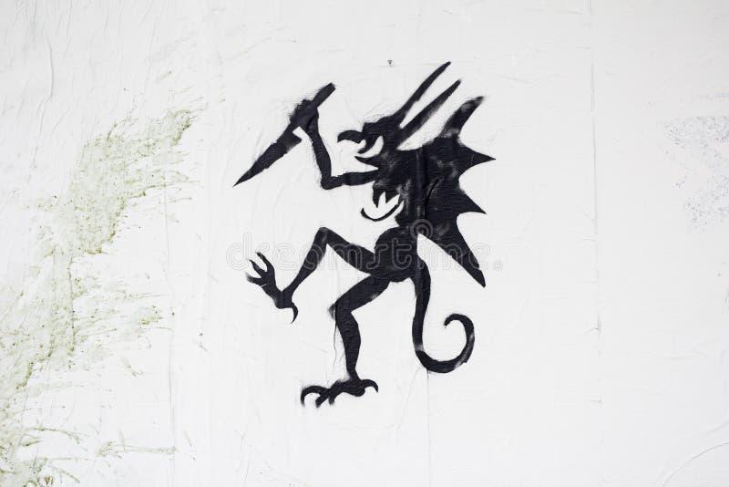 Дракон с шпагой стоковое изображение
