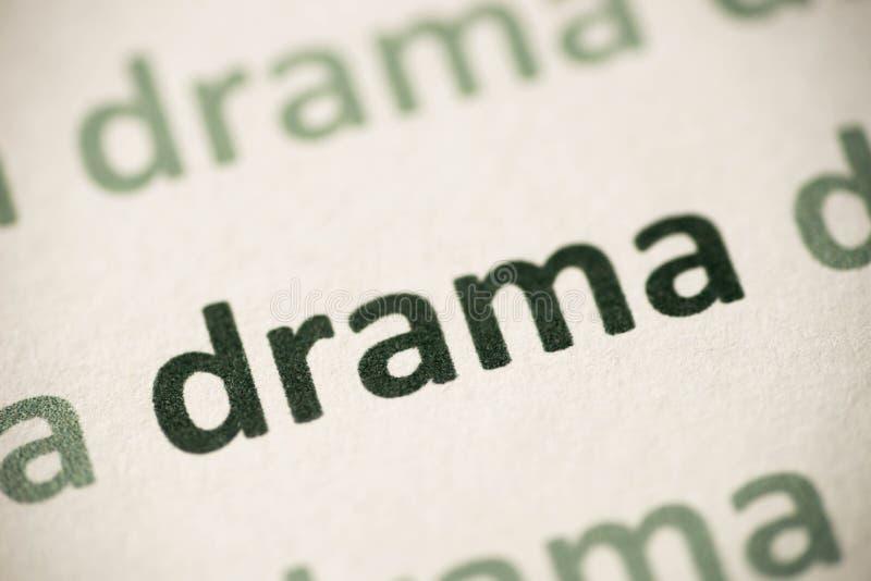Драма слова напечатанная на бумажном макросе стоковые изображения rf
