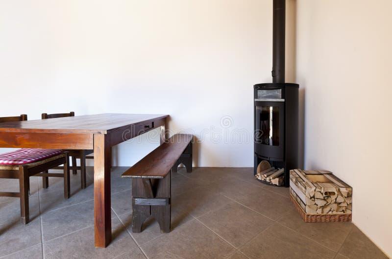 древесина таблицы печки комнаты стоковые изображения rf