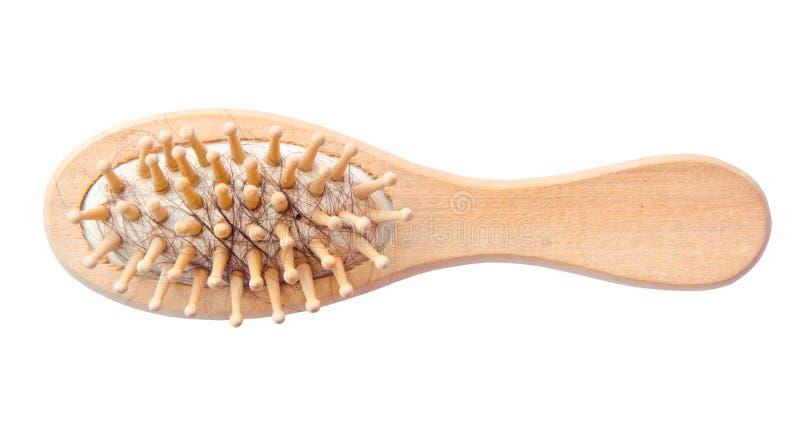 Древесина щетки волос с потерянными волосами на ем стоковые изображения rf