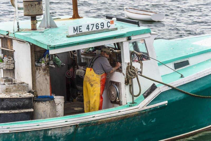 Дроссель Lobsterman работая стоковое изображение rf