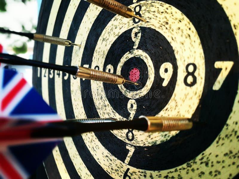 Дротики на dartboard стоковая фотография rf