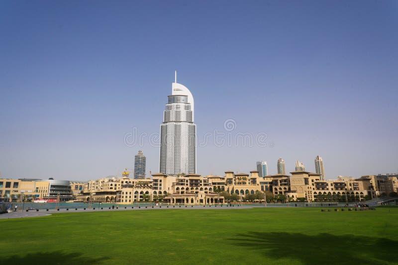 Дубай, ОАЭ - 15-ое января 2016: Дворец городской Дубай и гостиницы адреса в центре города на предпосылке  стоковая фотография rf