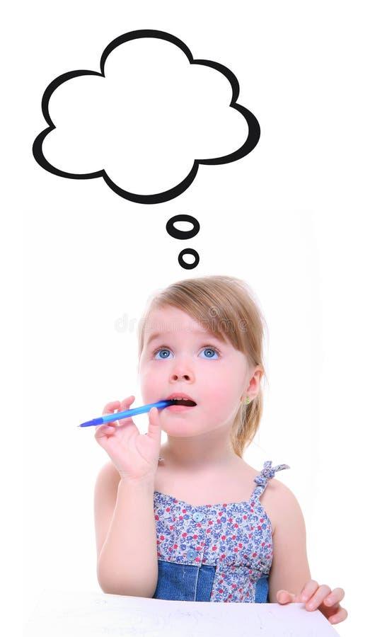 Думать маленькой девочки стоковое фото