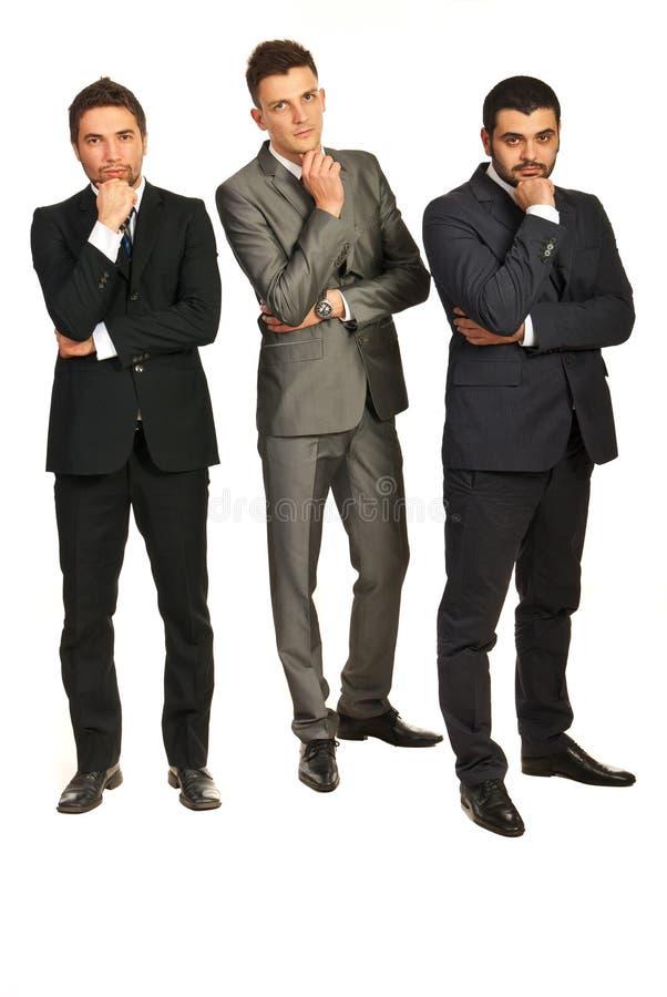 Думать 3 бизнесмена стоковые изображения