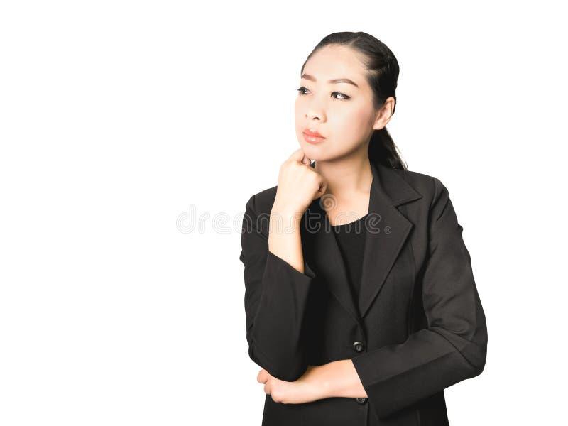 Думая женщина дела азиатская в черном костюме стоковое изображение