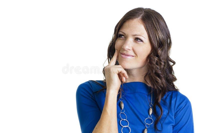 Думая женщина изолированная на белой предпосылке стоковая фотография rf