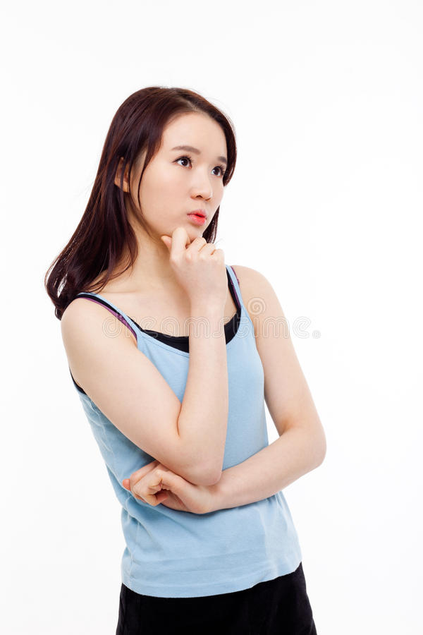 Думая молодая азиатская женщина стоковые изображения rf