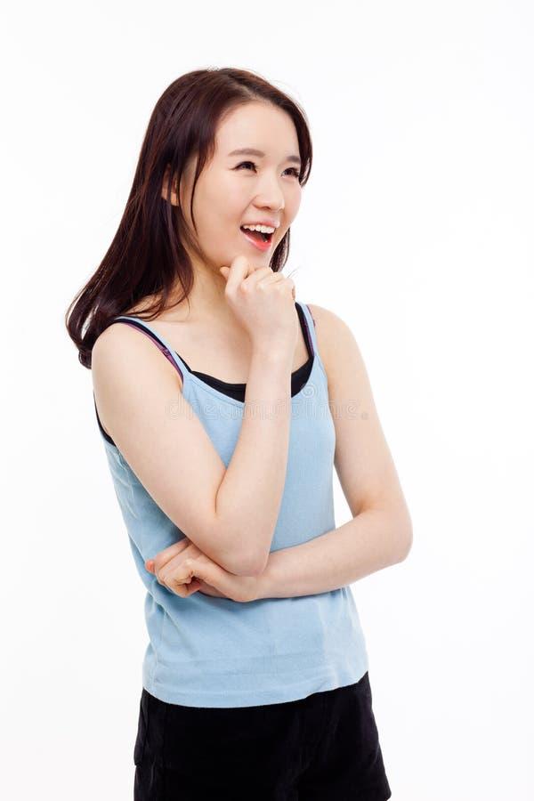 Думая молодая азиатская женщина стоковая фотография rf