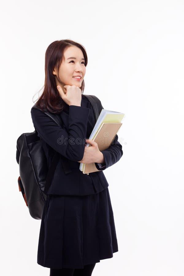 Думая молодой азиатский студент стоковое изображение