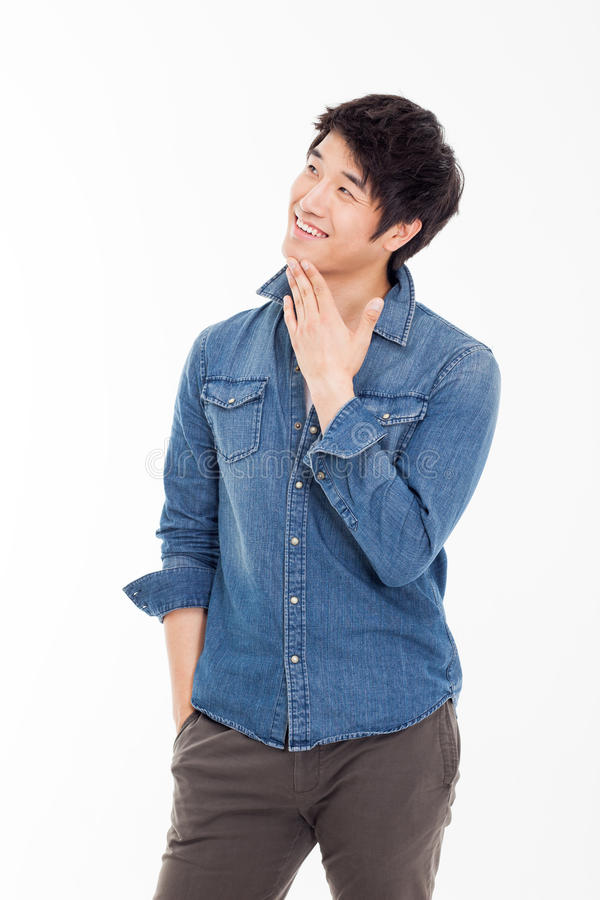Думая молодой азиатский человек стоковое фото rf