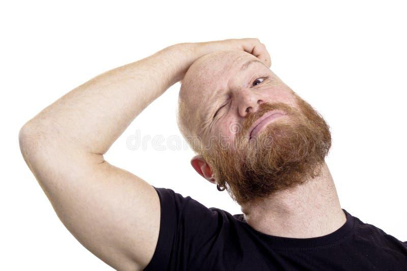 Думая человек царапая его голову стоковое изображение