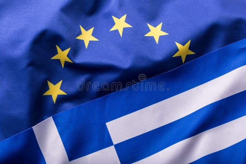 Европейский союз и Греция Концепция отношения между EC и Грецией Развевая флаг EC и Греции стоковое изображение rf