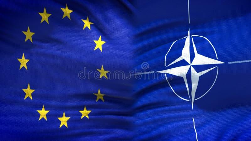 Европейский союз и предпосылка флагов НАТО, дипломатический и экономические отношения стоковое изображение