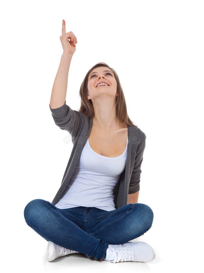 девушка указывая подростковое поднимающее вверх стоковая фотография