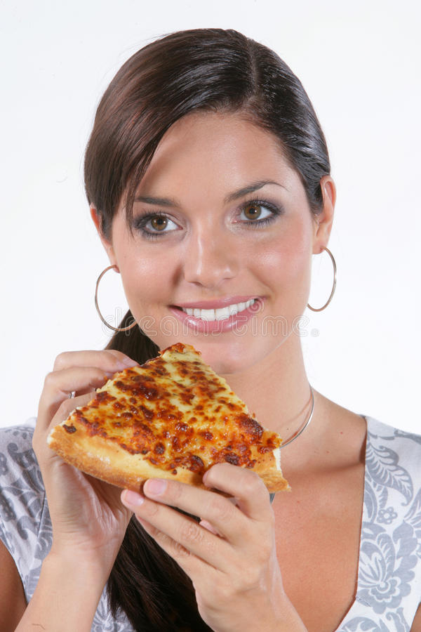 еда детенышей женщины пиццы стоковые изображения