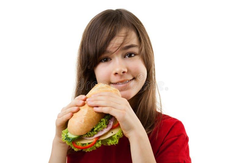 еда детенышей сандвича девушки здоровых стоковое фото rf