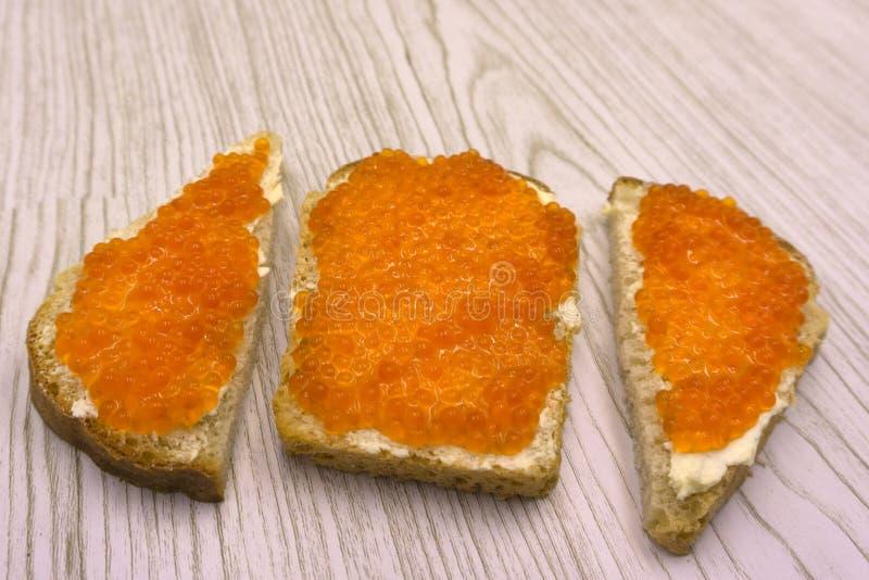 Еда красного протеина предпосылки конца-вверх икры здоровая стоковое фото rf
