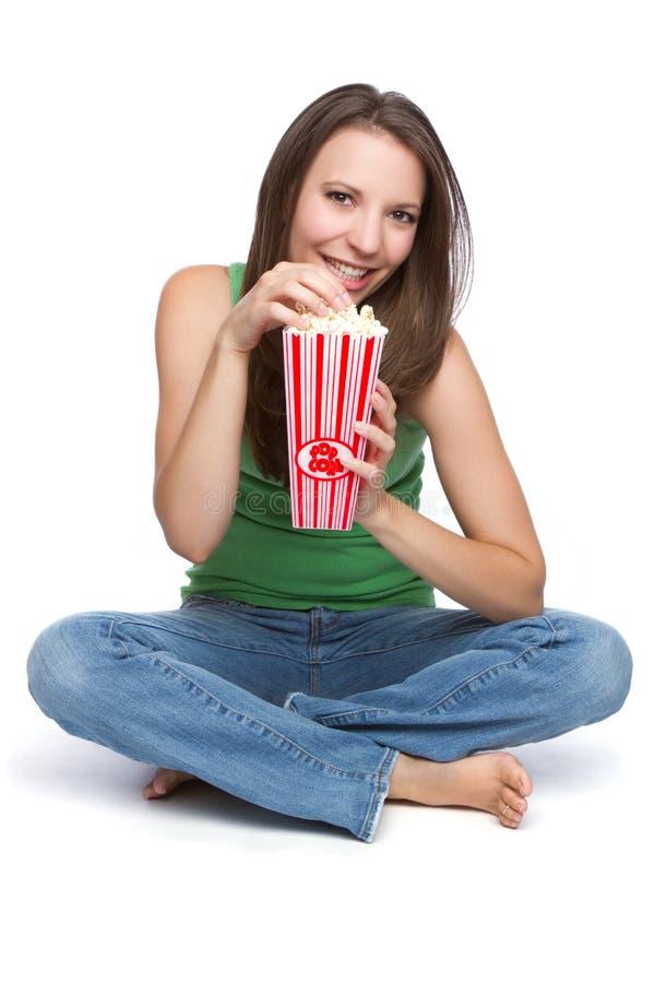 еда попкорна девушки стоковая фотография