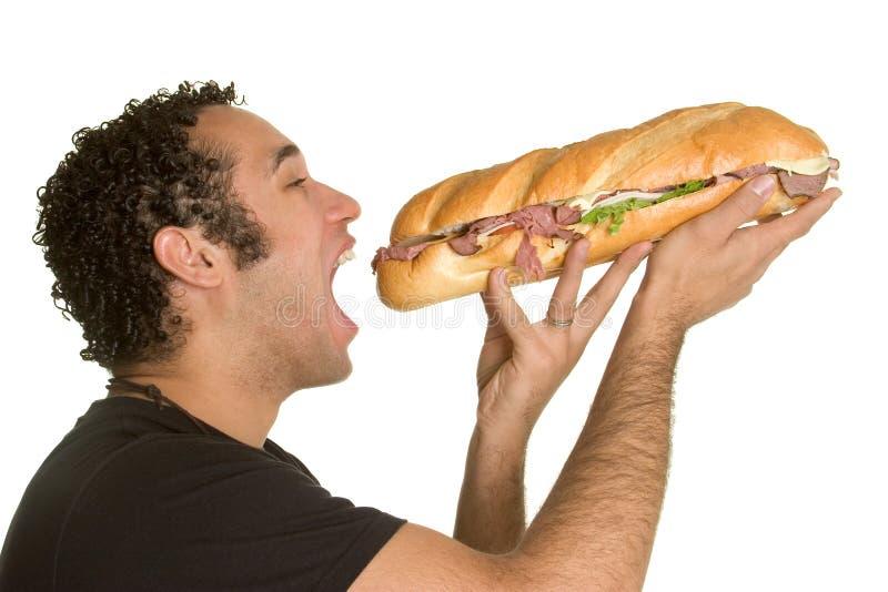еда сандвича человека стоковые изображения rf