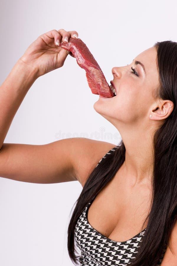 Едок мяса стоковое изображение