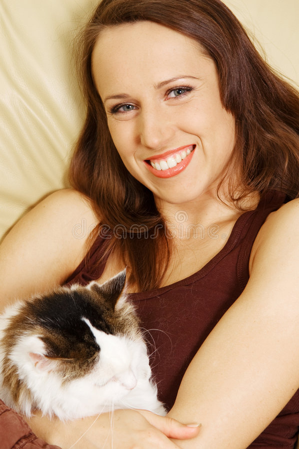 ее женщина smiley любимчика стоковое фото